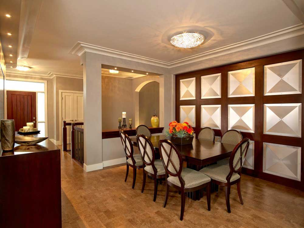 brown and gray dining set in room with wooden and silver-tiled walls