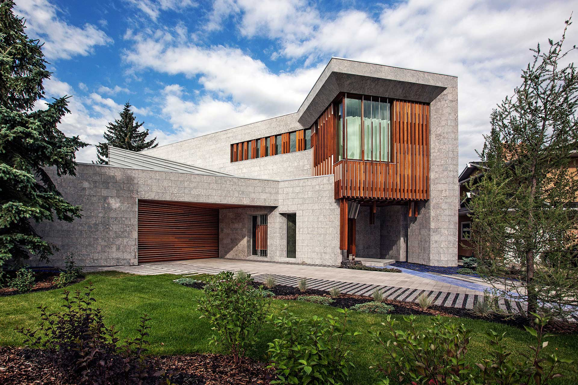 Concrete and wooden exterior of 2-story house