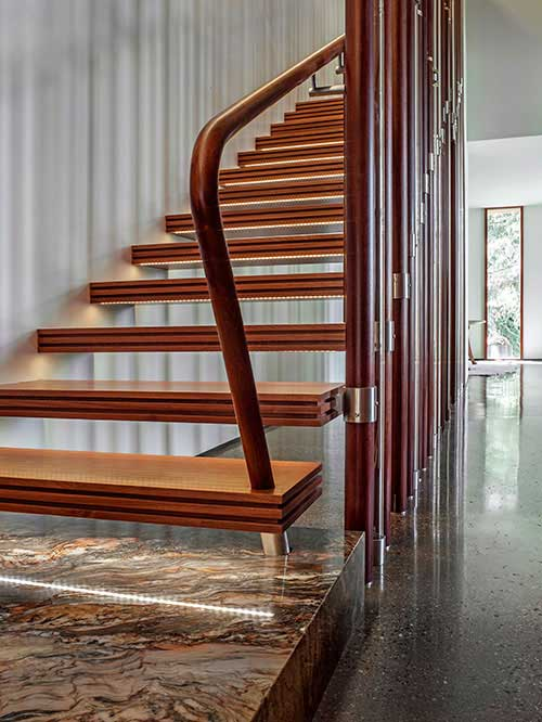 Staircase made with custom wooden steps, including lighting that's on