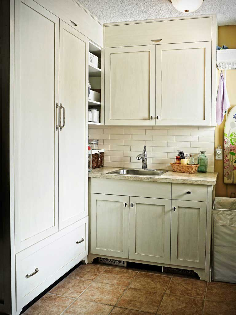 white wooden kitchen cupboard in rustic-looking kitchen