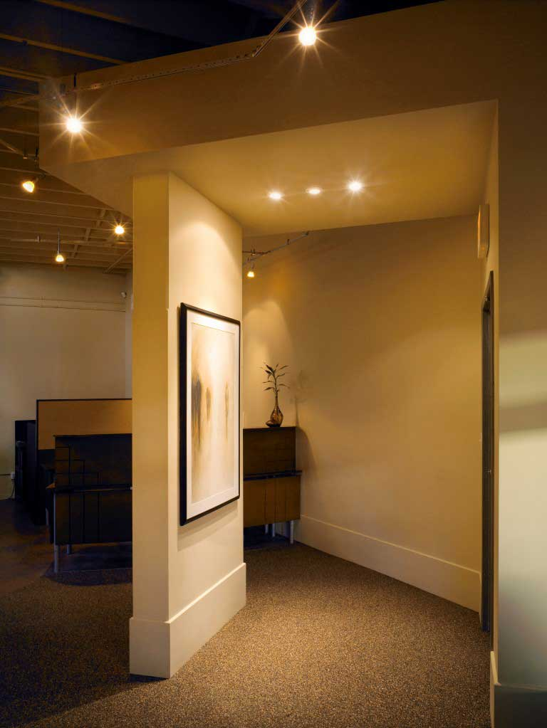white painted wall with large white baseboards